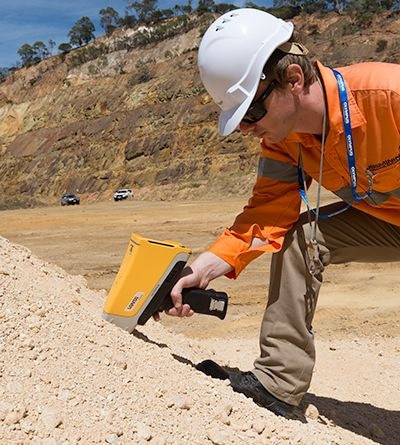 A Vanta pXRF analyzer being used to sample stockpiles