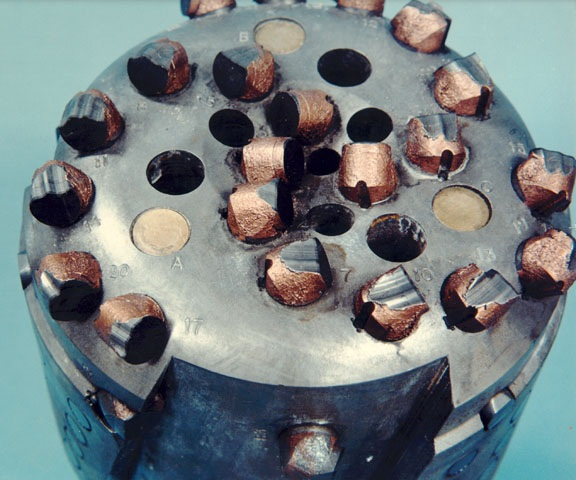 A drill bit with industrial diamond cutters in a matrix.